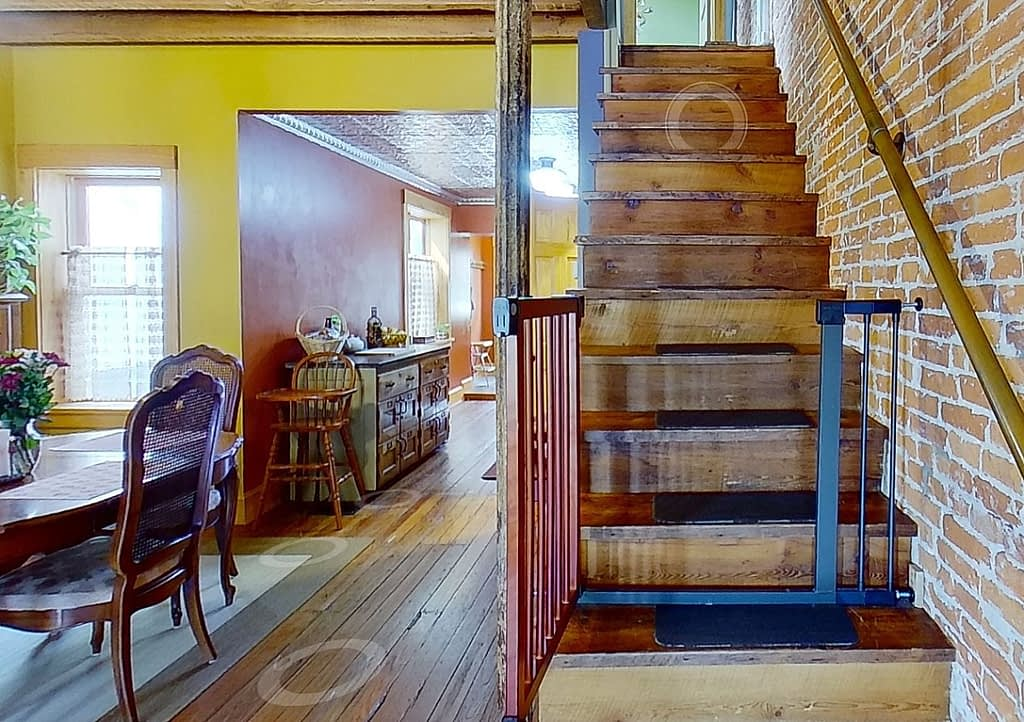 A view of 2539 Christian St from the foyer with the option to click up stairs or click towards the kitchen